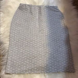 A grey mini skirt with white polka dots